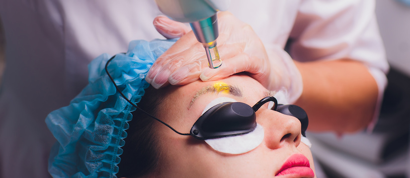 Woman undergoing eyebrow tattoo removal