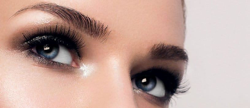 Close-up of a woman's eyes and eyebrows.