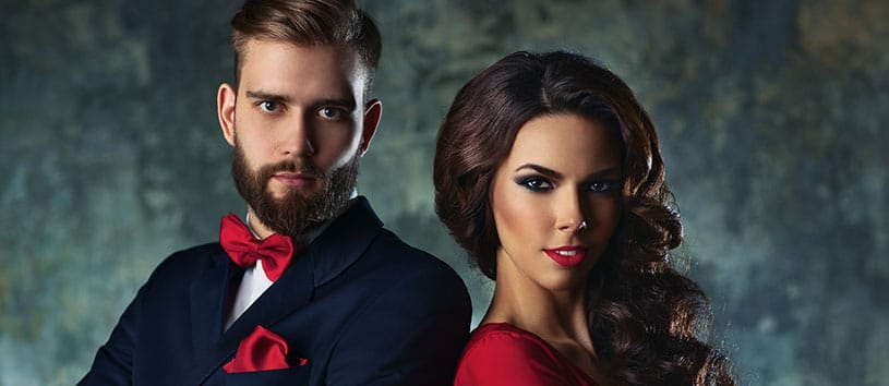 Man and woman standing together looking fierce.
