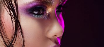 Close-up image of a woman with bright eye makeup.