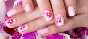 Closeup of a pink floral manicure.