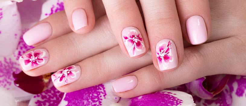 Closeup of a pink floral manicure.
