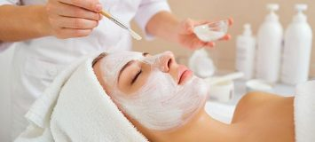 Woman receiving a facial treatment.